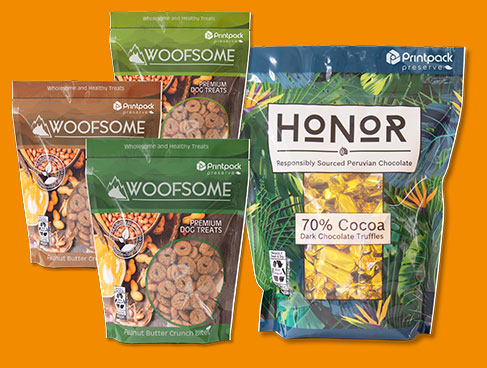 sealable pouches of Woofsome dog treats and Honor 70% cocoa